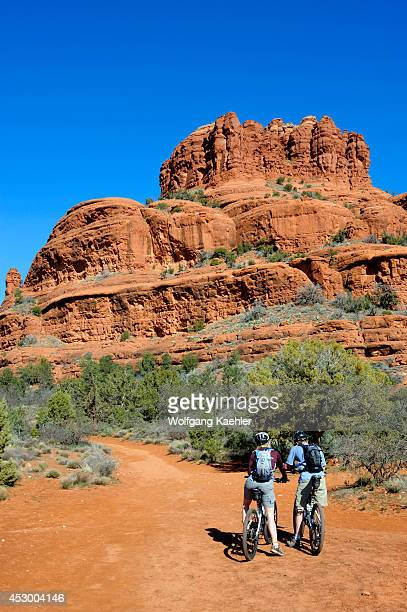 USA Arizona Sedona Bell Rock/courthouse Loop Trail View Of Red Rock Formations Bell Butte With Mountain Bikers
