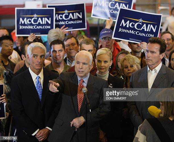 Arizona Senator and Republican presidential hopeful John McCain answers questions from reporters with Florida Governor Charlie Crist and California...