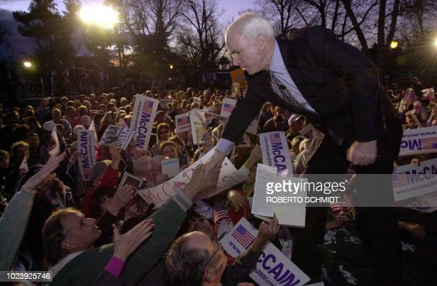 US Arizona Senator and Republican Presidential hopeful John McCain shakes the hand of a supporter at Jastro Park in Bakersfield CA 29 February 2000...