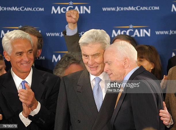 Arizona Senator and Republican presidential hopeful John McCain celebrates with Virginia Republican Senator John Warner and Florida Governor Charlie...