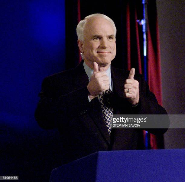 Arizona Senator and Republican presidential hopefull John McCain smiles as he participates in a Republican party nomination candidates debate via...