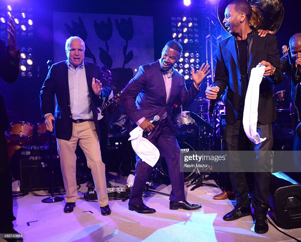 Arizona Senator John McCain and Jamie Foxx dance onstage at Apollo in the Hamptons at The Creeks on August 16, 2014 in East Hampton, New York.