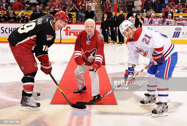 Arizona Senator John McCain drops the puck for Shane Doan of the Phoenix Coyotes and Brian Gionta of the Montreal Canadians at Jobingcom Arena on...