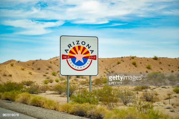 arizona state sign - us state border stock photos and pictures
