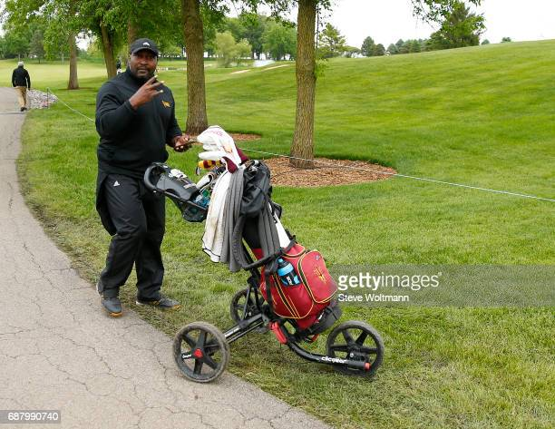 Arizona State Sr Associate Athletic Director helps push Olivia Mehaffey's cart back to the clubhouse after she completed play at the Division I...