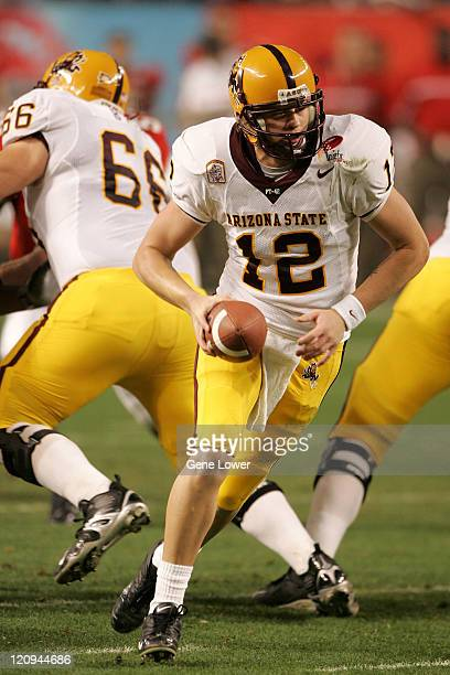 Arizona State Sun Devil quarterback Rudy Carpenter hands the ball off during the Insight Bowl against the Rutgers Scarlet Knights at Chase Field in...