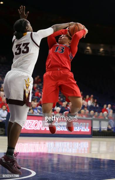 Arizona State Sun Devils center Charnea JohnsonChapman blocks Arizona Wildcats guard Marlee Kyles shot during the a college women's basketball game...