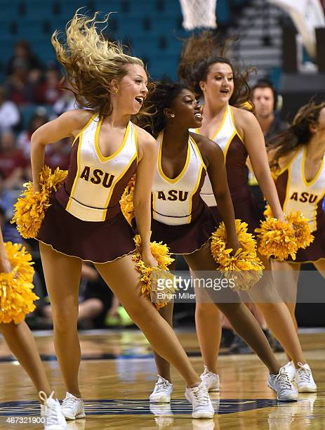 Arizona State Sun Devils cheerleaders perform during a firstround game of the Pac12 Basketball Tournament against the USC Trojans at the MGM Grand...