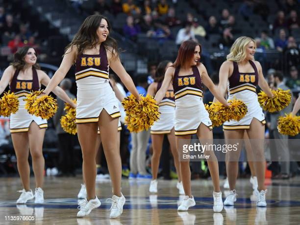 Arizona State Sun Devils cheerleaders perform during a quarterfinal game of the Pac-12 basketball tournament against the UCLA Bruins at T-Mobile...