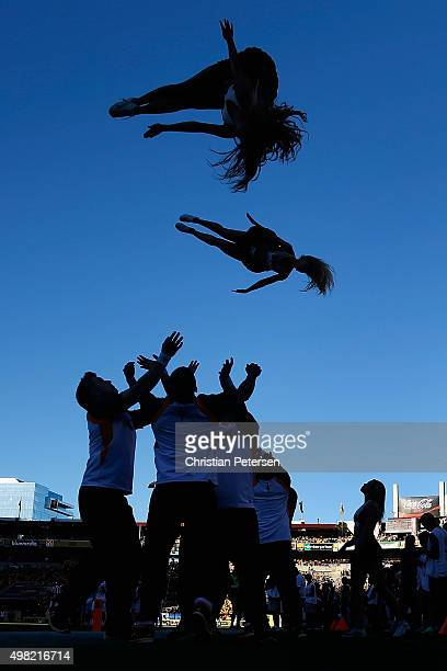 Arizona State Sun Devils cheerleaders perform during the college football game against the Arizona Wildcats at Sun Devil Stadium on November 21 2015...