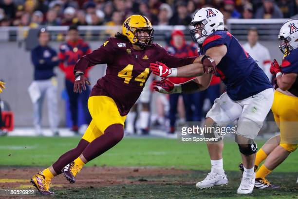 Arizona State Sun Devils defensive lineman TJ Pesefea rushes during the college football game between the Arizona Wildcats and the Arizona State Sun...