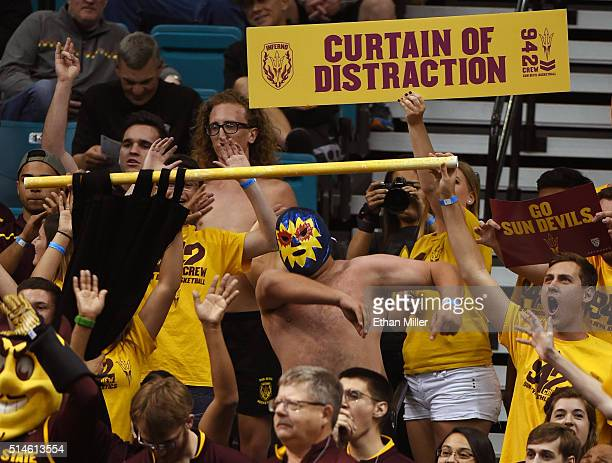 Arizona State Sun Devils fans try to distract an Oregon State Beavers player shooting a free throw during a firstround game of the Pac12 Basketball...