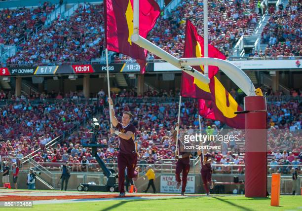 Arizona State Sun Devils flag holders run across the end zone after a touchdown during the regular season PAC12 game between the Stanford Cardinal...