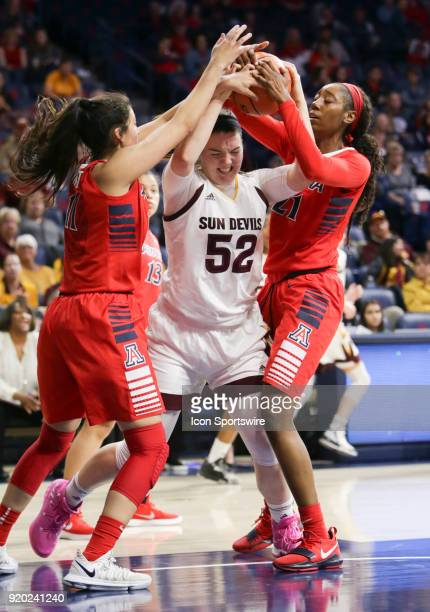 Arizona State Sun Devils forward Jamie Ruden tries to keep ahold of the ball while Arizona Wildcats forward Kat Wright and Arizona Wildcats forward...