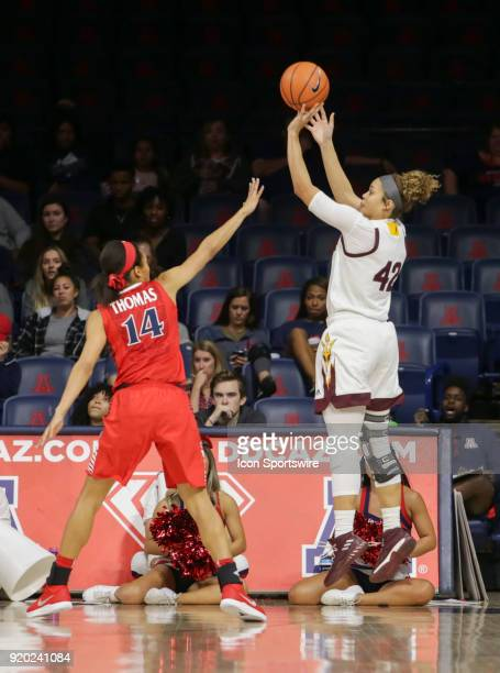 Arizona State Sun Devils forward Kianna Ibis shoots a three point shoot while Arizona Wildcats forward Sam Thomas tries to block it during the a...