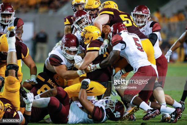 Arizona State Sun Devils fullback Mark Cosgrove gets surrounded by tacklers during the college football game between the New Mexico State Aggies and...