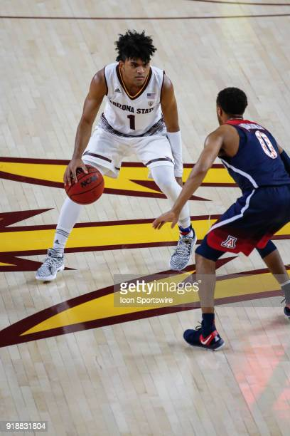 Arizona State Sun Devils guard Remy Martin looks to make a move on Arizona Wildcats guard Parker JacksonCartwright during the college basketball game...