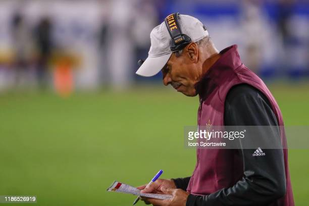 Arizona State Sun Devils head coach Herm Edwards checks his play card during the college football game between the Arizona Wildcats and the Arizona...