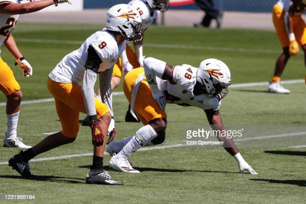 Arizona State Sun Devils linebacker Eric Gentry and Arizona State Sun Devils defensive lineman Travel Moore and line up during the college football...