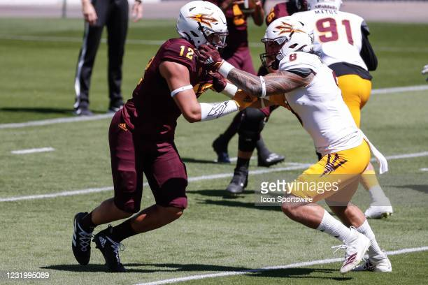 Arizona State Sun Devils linebacker Merlin Robertson covers Arizona State Sun Devils tight end Jalin Conyers during the college football spring...