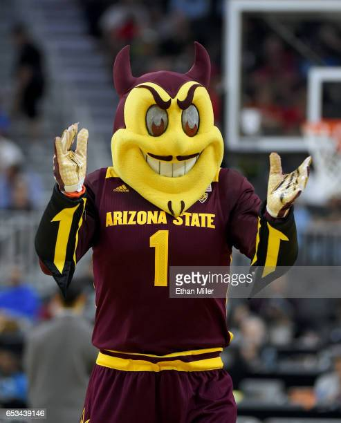 Arizona State Sun Devils mascot Sparky the Sun Devil performs during the team's quarterfinal game of the Pac12 Basketball Tournament against the...