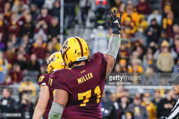 Arizona State Sun Devils offensive lineman Steven Miller holds up 3 fingers during the college football game between the Arizona Wildcats and the...