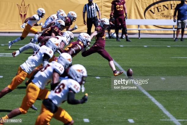 Arizona State Sun Devils place kicker Jace Feely kicks the ball off followed by teammates during the college football spring scrimmage of the Arizona...