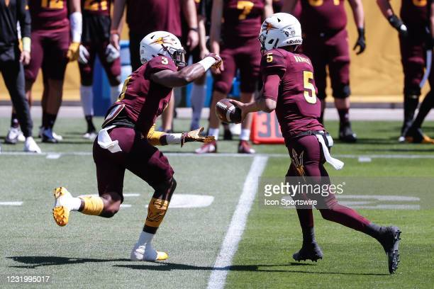 Arizona State Sun Devils quarterback Jayden Daniels hands the ball to Arizona State Sun Devils running back Rachaad White during the college football...