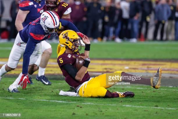 Arizona State Sun Devils quarterback Jayden Daniels slides during the college football game between the Arizona Wildcats and the Arizona State Sun...