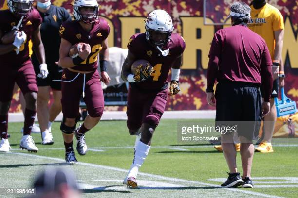 Arizona State Sun Devils running back Daniyel Ngata runs the ball during the college football spring scrimmage of the Arizona State Sun Devils on...
