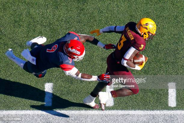 Arizona State Sun Devils running back Eno Benjamin outruns an attempted tackle by Fresno State Bulldogs linebacker Jeff Allison during the Mitsubishi...