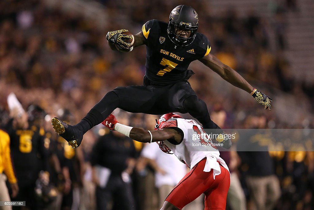 Arizona State Sun Devils running back Kalen Ballage (7) leaps over Utah Utes defensive back Jason Thompson (10) during the first half of the Pac-12 college football game on November 10, 2016, at Sun Devil Stadium in Tempe, AZ.