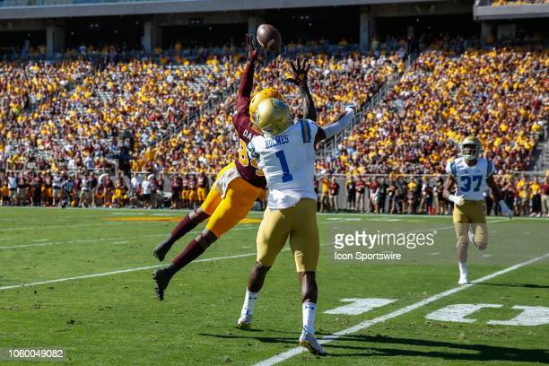 Arizona State Sun Devils wide receiver Frank Darby goes up for a pass defended by UCLA Bruins defensive back Darnay Holmes during the college...