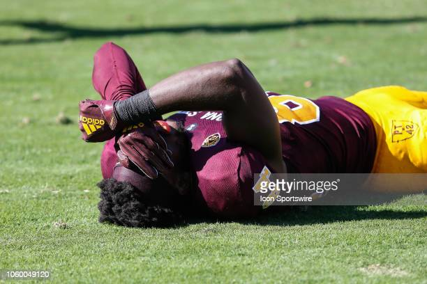 Arizona State Sun Devils wide receiver Frank Darby holds his head after being injured during the college football game between the UCLA Bruins and...
