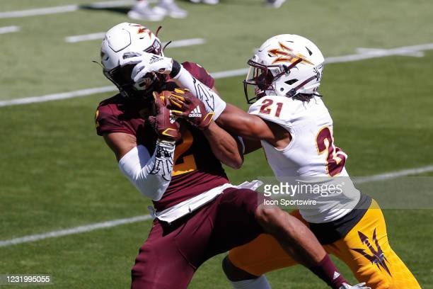 Arizona State Sun Devils wide receiver Geordon Porter catches a pass defended by Arizona State Sun Devils defensive back Robert Regan during the...