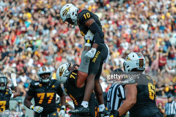 Arizona State Sun Devils wide receiver Kyle Williams and teammates celebrate a touchdown during the college football game between the USC Trojans and...