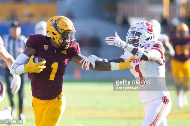 Arizona State Sun Devils wide receiver N'Keal Harry tries to stiff arm Utah Utes defensive back Jaylon Johnson during a college football game between...