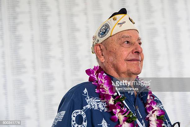 S Arizona survivor Lou Conter looks on near the Arizona Remembrance Wall during a memorial service marking the 74th Anniversary of the attack on the...