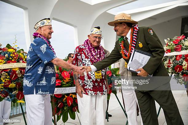 S Arizona Survivor Louis Conter and National Parks Historian Daniel Martinez shake hands after a memorial service marking the 74th Anniversary of the...