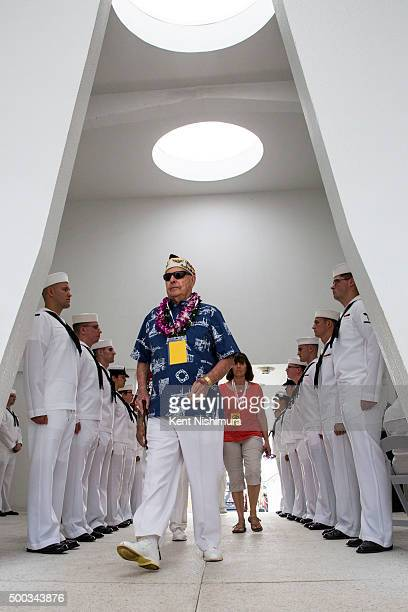 S Arizona Survivor Louis Conter enters the Arizona Memorial during a memorial service marking the 74th Anniversary of the attack on the US naval base...