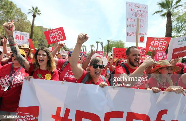Arizona teachers chant in support of the #REDforED movement as they walk through downtown Phoenix on their way to the State Capitol on April 26 2018...