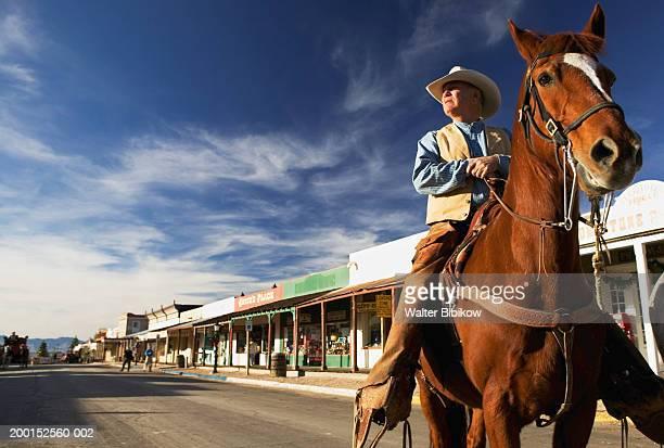usa, arizona, tombstone, mature cowboy on horseback - tombstone arizona stock pictures, royalty-free photos & images