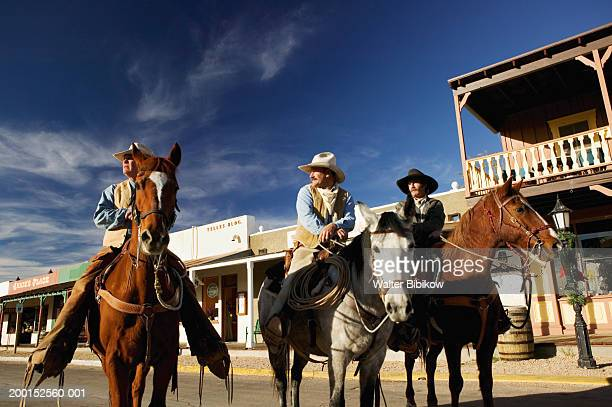 usa, arizona, tombstone, three cowboys on horseback - tombstone stock pictures, royalty-free photos & images