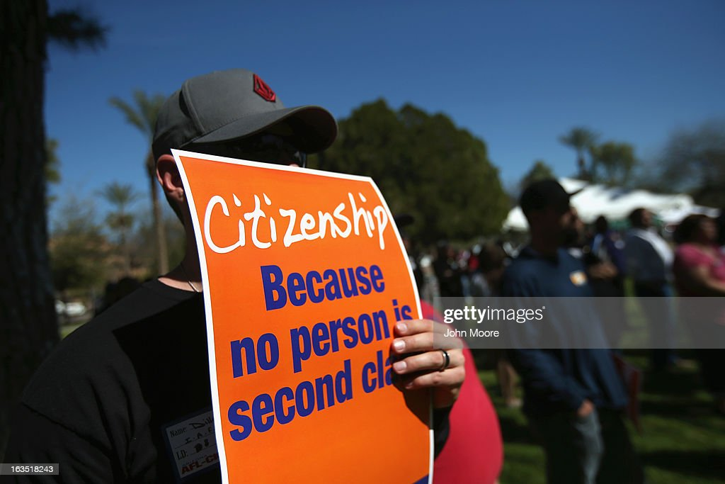 Arizona union supporters gather in support of national immigration reform outside the Arizona State Capitol building on March 11, 2013 in Phoenix, Arizona. The rally, organized by the AFL-CIO, was the last of a national tour in support of immigration reform which protects workers' rights. Photo by John Moore/Getty Images)