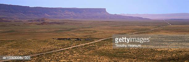 usa, arizona, vermillion cliffs, road through flatlands with vermillion cliffs in background - timothy hearsum stock pictures, royalty-free photos & images