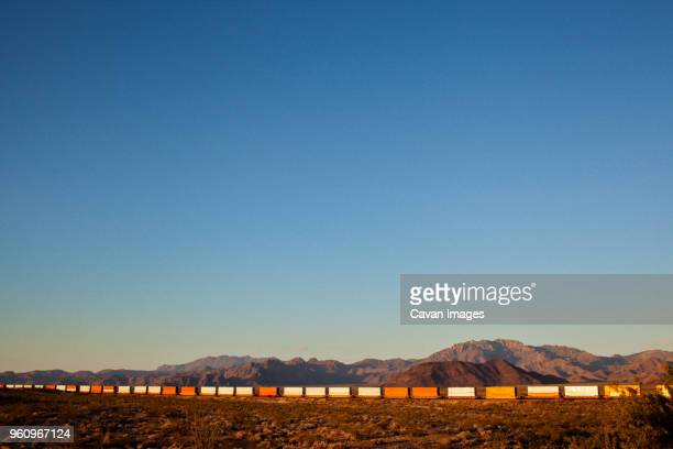 arizona, view of long train in desert - cargo train stock photos and pictures