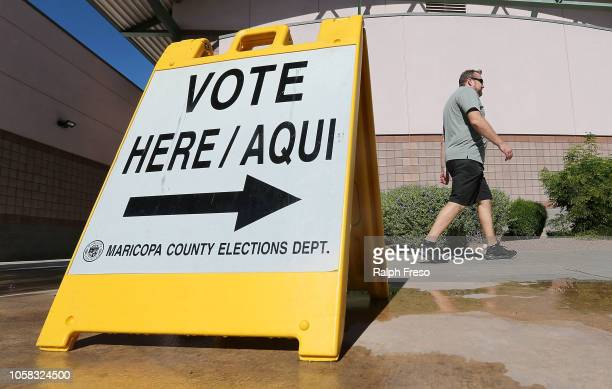 Arizona voters make their way to a polling place to cast their ballot during the midterm elections on November 6, 2018 in Phoenix, Arizona. Arizonans...