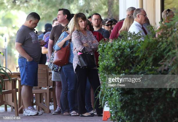 Arizona voters wait in line to cast their ballot at a polling place during the midterm elections on November 6, 2018 in Phoenix, Arizona. Arizonans...