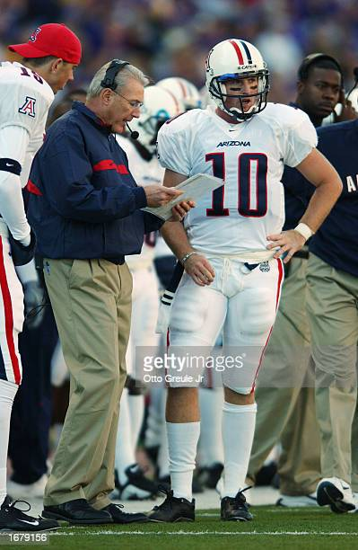 Arizona Wildcat coach John Mackovic discusses strategy with quarterback Jason Johnson during the NCAA football game against the Washington Huskies at...