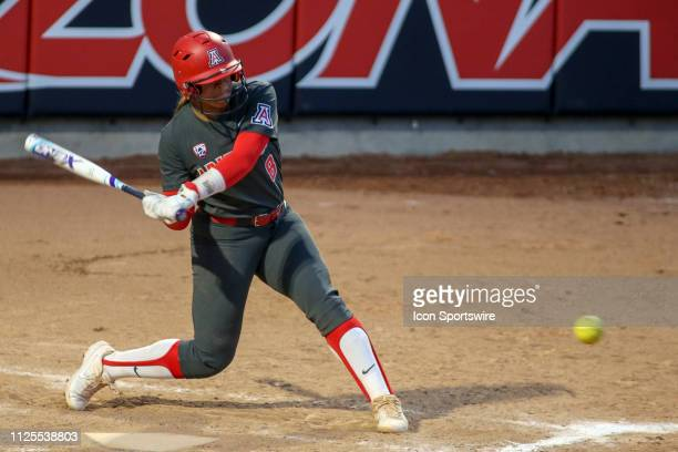 Arizona Wildcats catcher Dejah Mulipola swings at the ball during a college softball game between the Alabama Crimson Tide and the Arizona Wildcats...